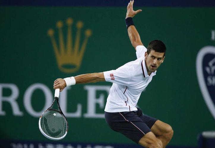 El español David Ferrer tratará de frenar la impresionante racha de Novak Djokovic (foto), en Shanghai. (Foto: AP)