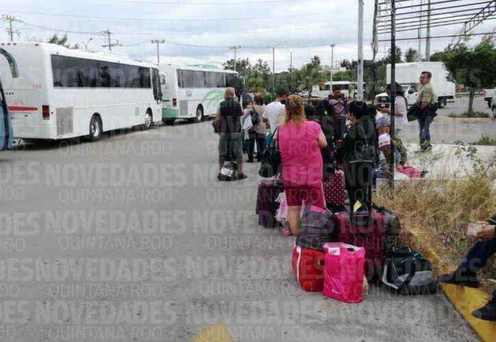 Se prevé que cientos de cancunenses viajen a la toma de protesta del presidente electo Andrés Manuel López Obrador. (Sergio Orozco)