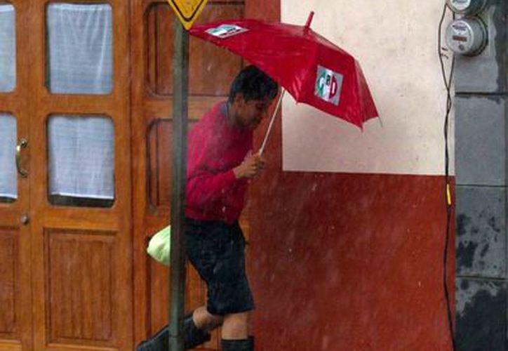 'Barry' ocasionó intensas lluvias en varios estados del país, incluyendo Oaxaca. La imagen es de Veracruz. (Notimex)