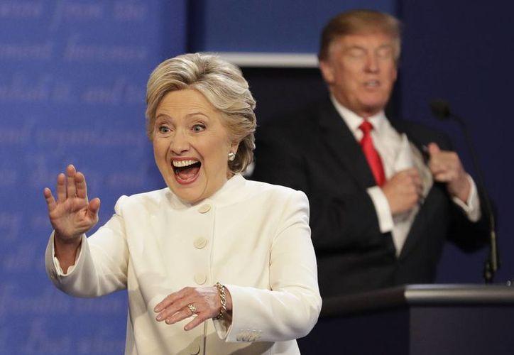 Hillary Clinton y Donald Trump no estrecharon sus manos ni al inicio ni al final del tercer debate. (AP Photo/John Locher)