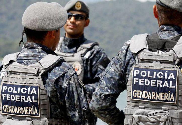 Miembros de la CNTE anunciaron que tomarán bajo resguardo las 13 mil escuelas que tiene bajo para evitar el ingreso de la Gendarmería. Imagen de la policía federal que forma parte del plan integral por la educación en Oaxaca. (Archivo/Notimex)
