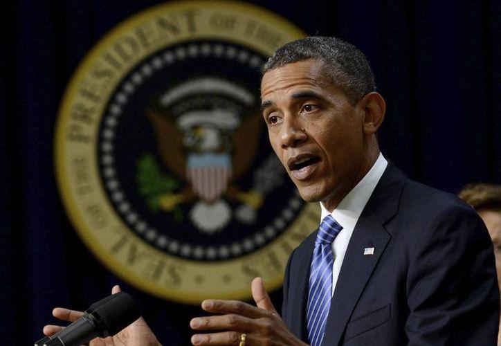 Obama dijo que Estados Unidos responderá 'proporcionalmente' al ataque a Sony Pictures. (EFE/Archivo)