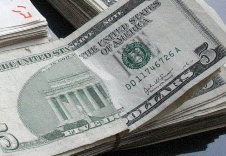 En Nuevo Laredo y Reynosa se registró el menor precio de la divisa. (Archivo/SIPSE)