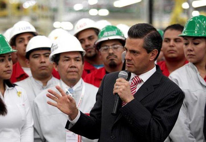 Peña Nieto dijo que con la reforma financiera se busca fortalecer el mercado interno. (Presidencia)