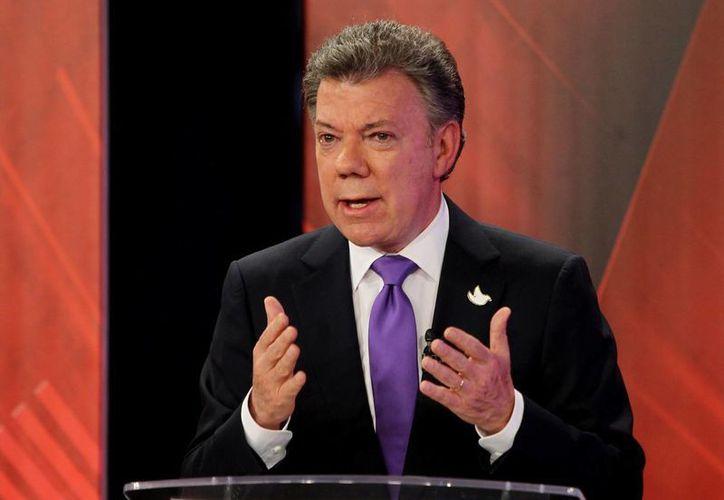 Santos afirmó que no habrá 'ningún acuerdo parcial' con las guerrillas. (EFE/Archivo)