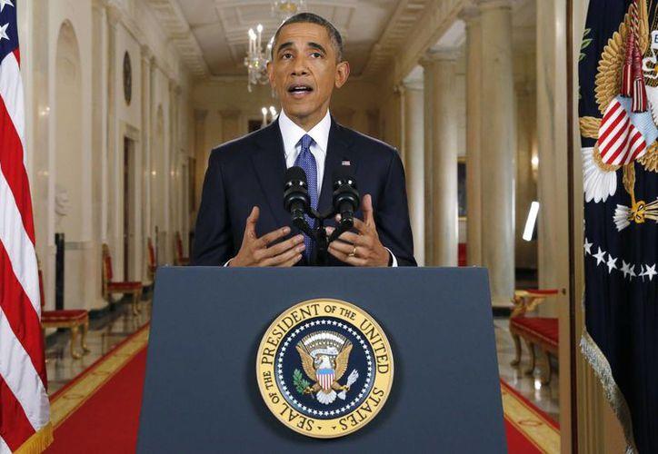 Obama advirtió que las medidas de alivio migratorio que anunció este jueves no son una amnistía. (AP)