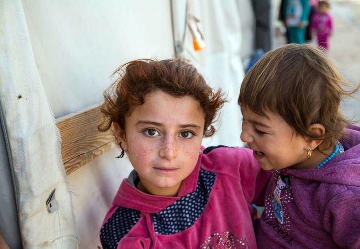 Según la Unicef, en el mundo existen 28 millones de niños que han sido desarraigados de sus hogares por conflictos bélicos. (Notimex)