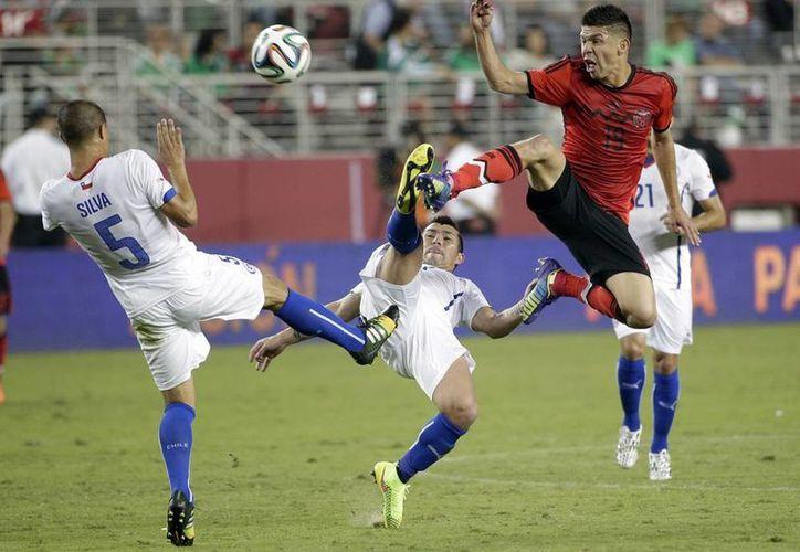 El sábado, el Tri ofreció un buen partido contra Chile, el cual terminó en empate 0-0. (AP)