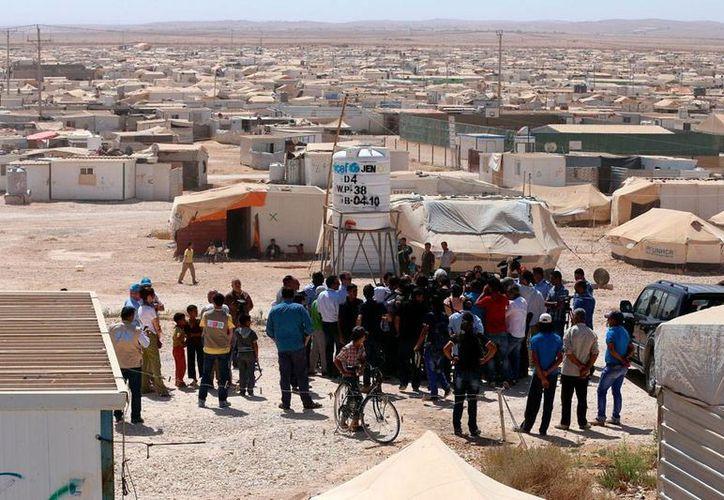 Filial de Al Qaeda en Siria mató a más de 40 soldados presioneros. La imagen corresponde a un campo de refugiados sirios, deplazados por la guerra, y está utilizada sólo con fines ilustrativos. (AP)
