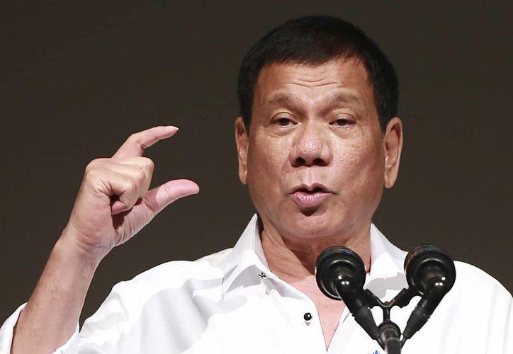 El presidente Rodrigo Duterte ha arremetido contra el presidente estadounidense, Barack Obama, y otros críticos, de su campaña antidrogas. (AP/Eugene Hoshiko)