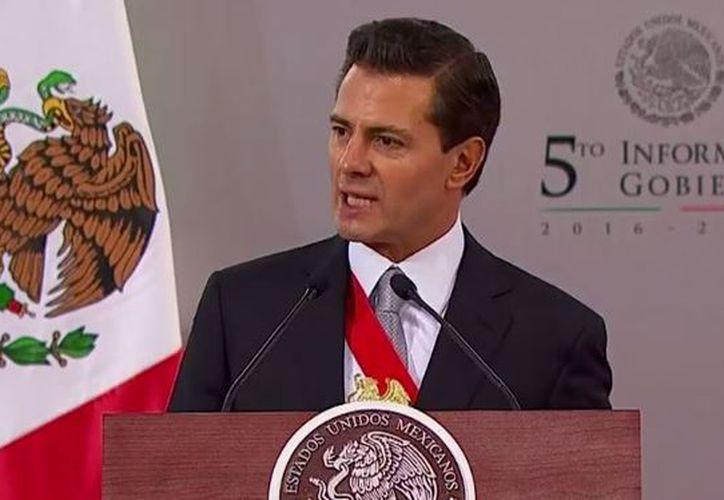 Enrique Peña Nieto, en su Quinto Informe de Gobierno. (Redacción)