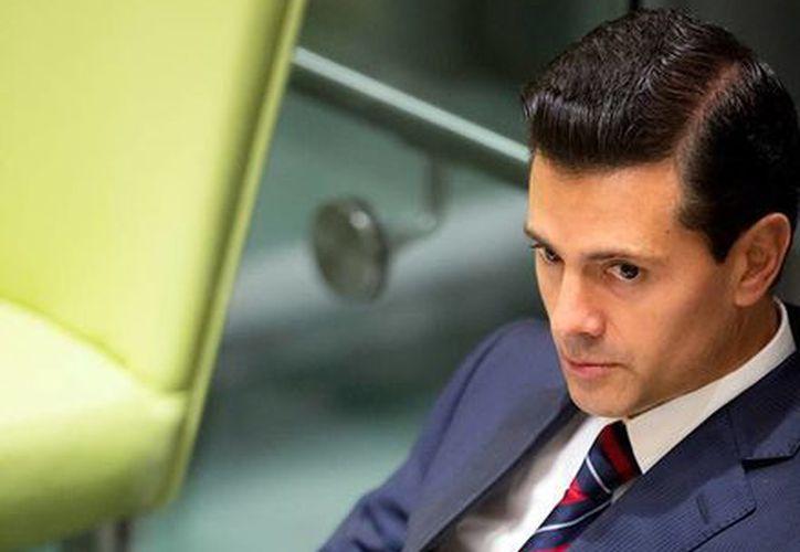 El presidente Enrique Peña Nieto dice que no se arrepiente de la reunión que sostuvo con el candidato republicano a la Casa Blanca . (facebook.com/EnriquePN)