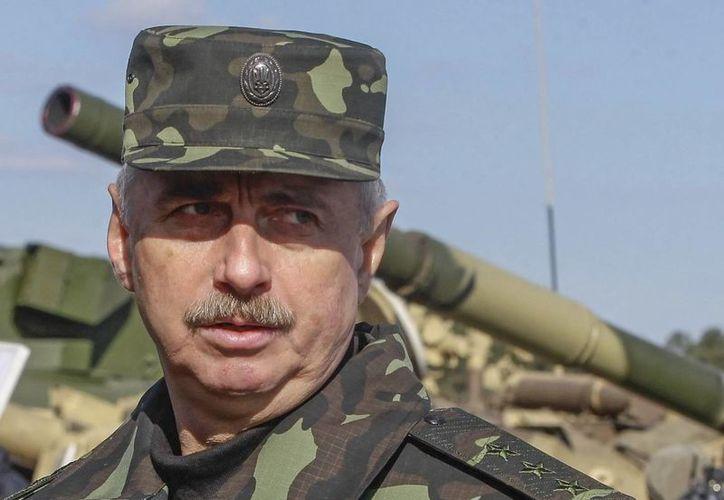 El ministro de Defensa ucraniano, Mijaíl Koval, rindió el informe luego de darse a conocer el derribo de un avión militar este sábado . (EFE/Archivo)
