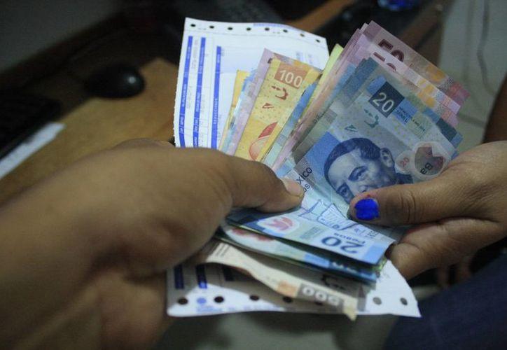 La iniciativa privada tenía entre sus planes elevar el salario mínimo a los casi 90 pesos en el transcurso de 2017. (Archivo/ Milenio Novedades)