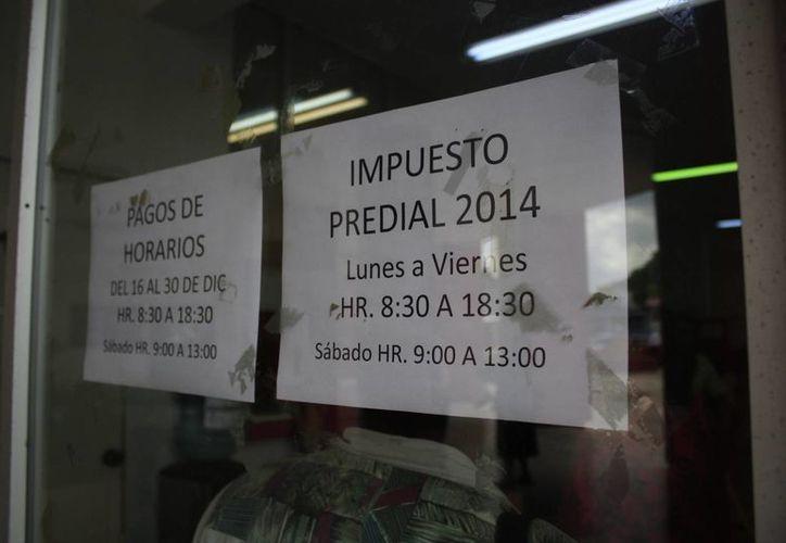 En diciembre del año pasado, para la recaudación del predial fueron instalados más de 15 módulos de atención en la capital. (Harold Alcocer/SIPSE)
