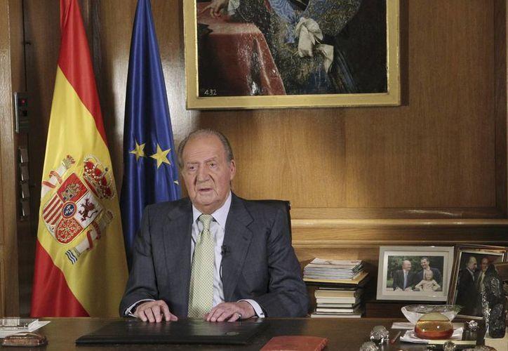 El rey Juan Carlos todavía no comunica los motivos para su abdicación. (Foto de archivo: AP)