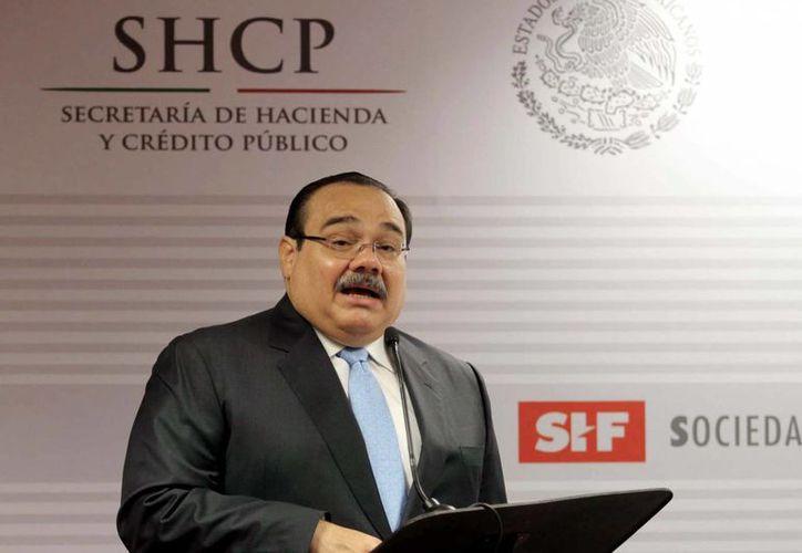 Ramírez Marín indicó que para 2014 habrá fondos suficientes para impulsar la vivienda. (Notimex)