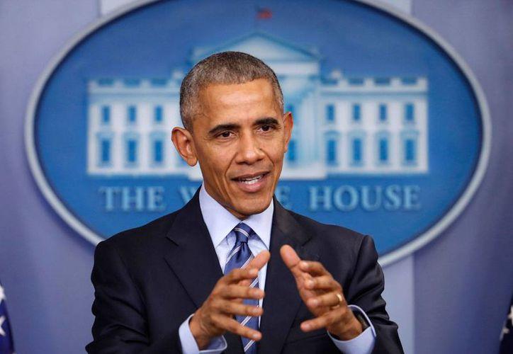 Imagen del 16 de diciembre de 2016, del presidente Barack Obama durante una conferencia de prensa en la Casa Blanca. Este 29 de diciembre de 2016, Obama impuso sanciones a funcionarios rusos por interferir en la elección presidencial, que ganó Donald Trump. (AP/Pablo Martínez Monsiváis)
