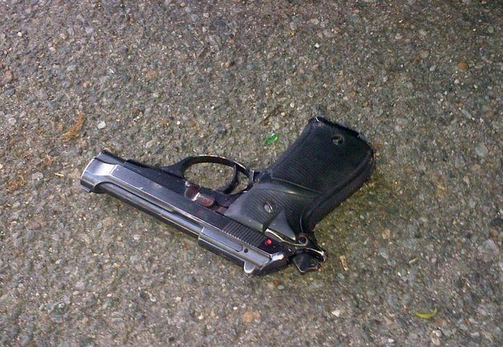 El diario The Baltimore Sun reportó que 35 personas fueron asesinadas en mayo, que se convierte así en el mes más mortífero desde diciembre de 1999. Foto de contexto de un arma de fuego que es evidencia de una balacera. (AP)