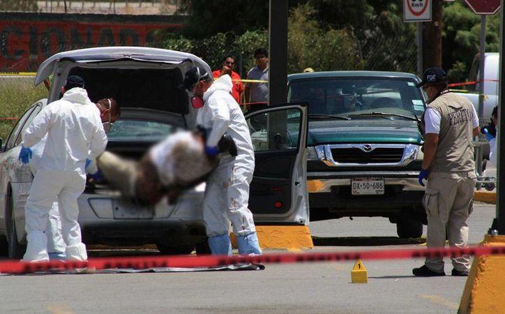 Las cifras de la PGR reflejan que en el sexenio de Felipe Calderón se cometieron 63 mil 195 homicidios relacionados con el crimen organizado. (proceso.com.mx)