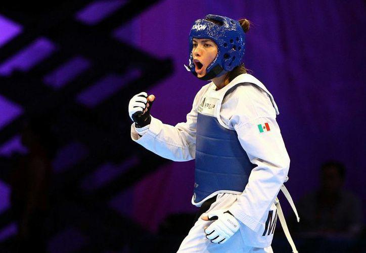 La doble medallista olímpica, María del Rosario Espinoza, está consciente del compromiso que representa ser parte de un deporte en el cual se tienen las últimas esperanza de subir al podio. (Archivo/ Agencias)