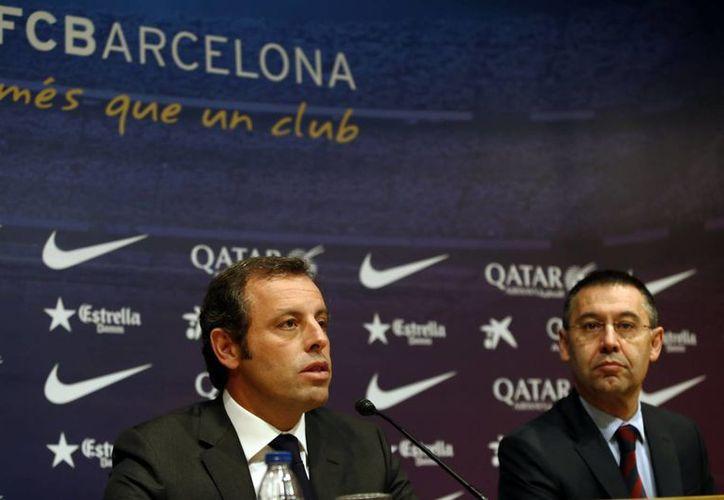 El expresidente del FC Barcelona, Sandro Rosell (i), y el actual dirigente, Josep Maria Bartomeu (d), podrían ir a prisión debido al irregular fichaje de Neymar. (EFE/Archivo)
