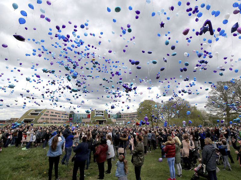 People release balloons outside Alder Hey Children's Hospital following the death of 23-month old Alfie Evans.