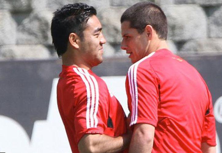 Chicharito y Marco Fabián fortalecen su amistad al vivir en Alemania. (Expreso)