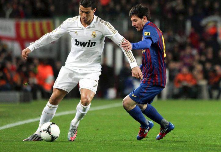 2015 será un año de más competencia para Cristiano Ronaldo y Lionel Messi. (Agencias)