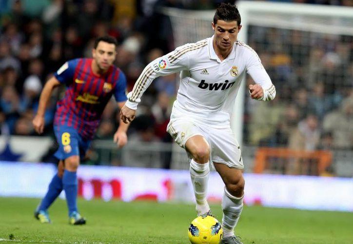 Cristiano Ronaldo, que tiene un sueldo de ensueño con Real Madrid, podría ganar más dinero en China, pero él no quiere. (afternoongossip.com)