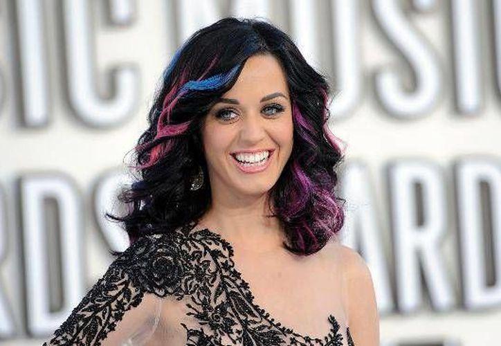 La cantante californiana Katy Perry celebrará su cumpleaños número 31 este domingo. Perry inició desde muy pequeña en el ámbito musical aunque en su casa siempre se le exigió cantar y escuchar música religiosa. (Imágenes de AP y Notimex)
