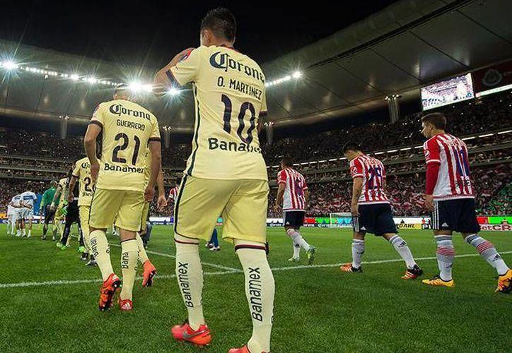 América y Guadalajara por un clásico más en liguilla. Ésta es la quinta vez que ambos equipos chocan en la segunda fase del torneo y las Águilas van ganando por tres series a una. (Archivo/Mexsport)