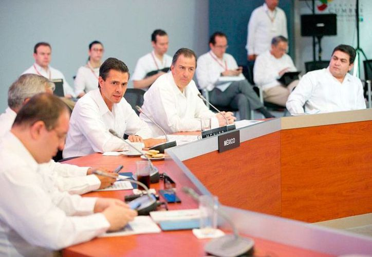 El presidente de México, Enrique Peña Nieto, advirtió de los riesgos que conlleva el cambio climático y pidió abatir mitos en torno al tema, durante la VI Cumbre de Asociación de Estados del Caribe. (presidencia.gob.mx)
