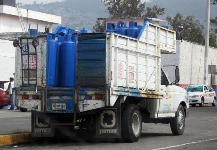 El mercado de gas LP entrará en un esquema similar de las gasolinas por la liberación de precios e importación. (Archivo/Notimex)