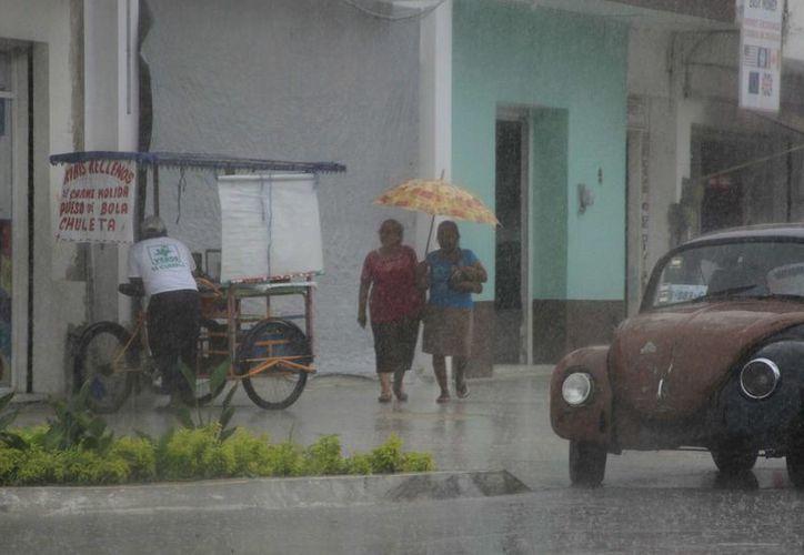 Alrededor de las 11:00 de la mañana, las lluvias empezaron a caer. (Harold Alcocer/SIPSE)