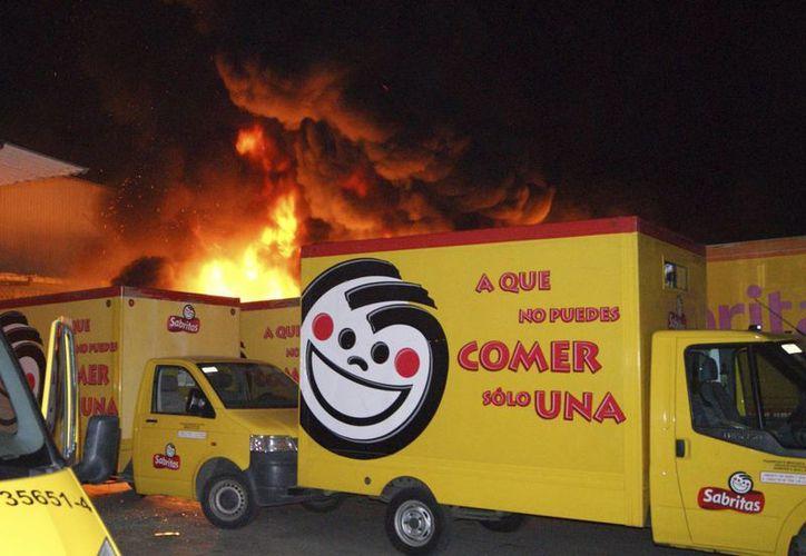 En mayo del año pasado, en Michoacán se vivió una escalada de violencia que afectó a varias empresas, como la transnacional Pepsico. (Imagen de archivo/AP)