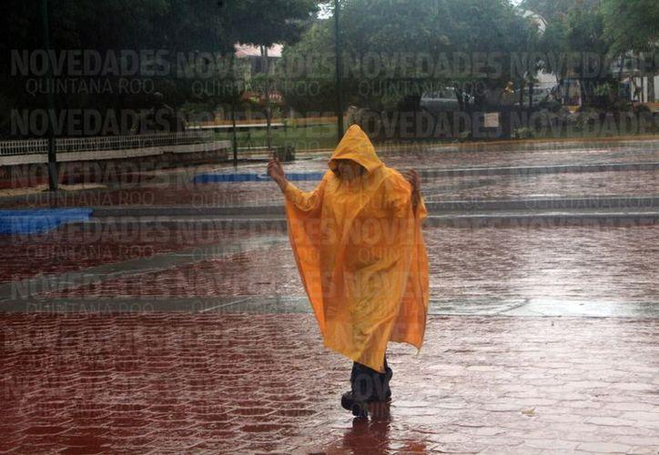 El gobierno del estado instaló, en coordinación con los municipios, las sesiones de operación tormenta para estar atentos y apoyar a la gente. (Paola Chiomante)