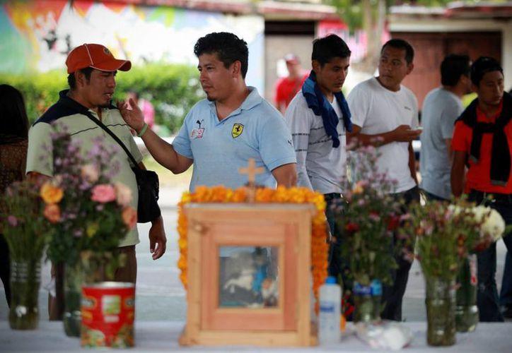 Los últimos datos oficiales divulgados indican que los policías de Iguala habrían sido los responsables de la desaparición de los estudiantes. (AP)