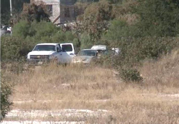 Predio en el municipio de La Barca, Jalisco, donde desde hace días se exhuman cuerpos de fosas clandestinas. (Captura de pantalla de YouTube)
