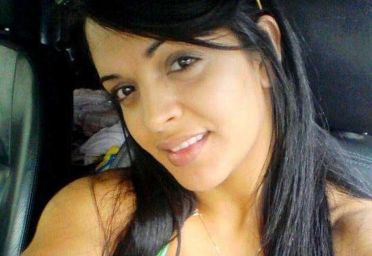 Amanda Bueno, quien se hizo famosa hace menos un de años por ser la 'Novia del Mundial' fue masacrada. (eldictamen.mx)