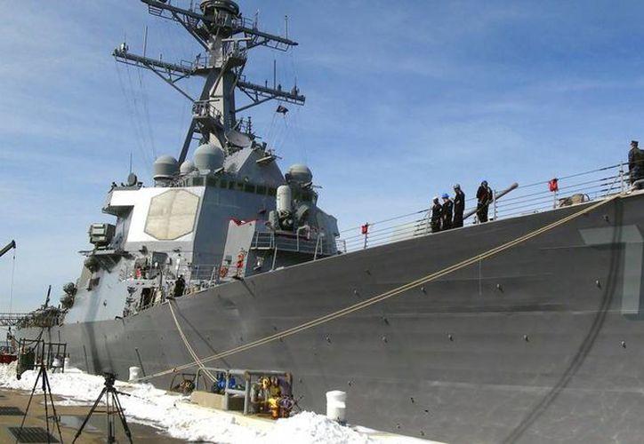 Rodeados de nieve y familiares, los 338 marinos del destructor estadounidense USS Donald Cook se disponen a partir a su nuevo hogar: la base naval de Rota en España, en el inicio del despliegue del escudo antimisiles de la OTAN en la región mediterránea. (EFE)