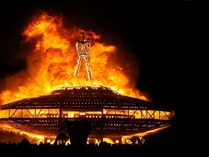 "In this Aug. 31, 2013, file photo, the ""Man"" burns on the Black Rock Desert at Burning Man near Gerlach, Nev. Larry Harvey, the co-founder of the  ""Burning Man"" festival has died. He was 70."