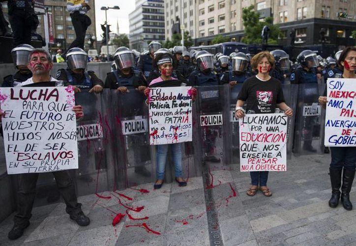 Las autoridades capitalinas indicaron que fueron más de 67 expresiones de apoyo a la CNTE en diversas partes de la ciudad. (AP)