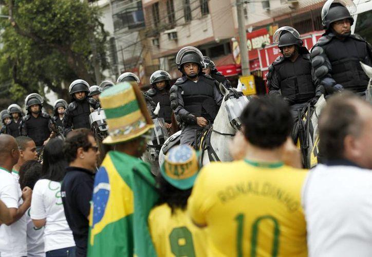 Demandan que 'En Río de Janeiro la pobreza es racial'. (EFE)