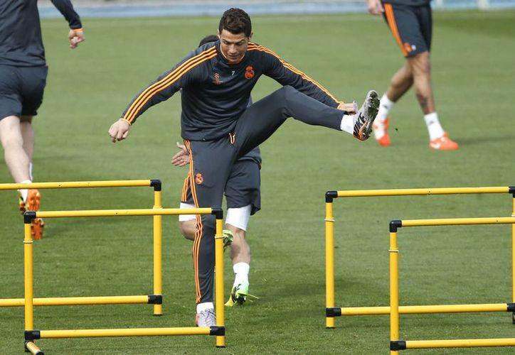 Por la lesión muscular que sufre, Cristiano Ronaldo se perderá su segundo partido de Liga consecutivo ante el Almería. (EFE/Archivo)