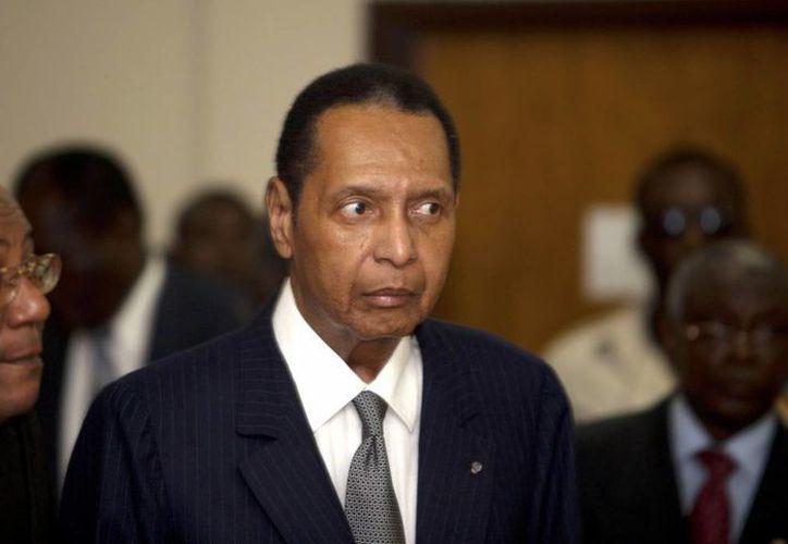 Jean-Claude Duvalier, en febrero de 2013 durante su proceso penal en la corte de Puerto Príncipe, Haití. Al final solo tuvo que encarar cargos financieros, pero no los relacionados con abusos. (Foto: AP)