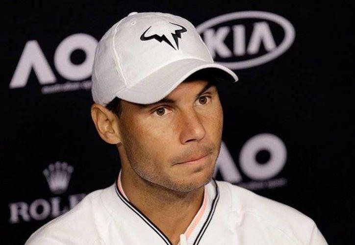 Rafael Nadal se prepara para encarar el Abierto de Australia, torneo en el que debutará el próximo martes 17 de enero.(Archivo/AP)