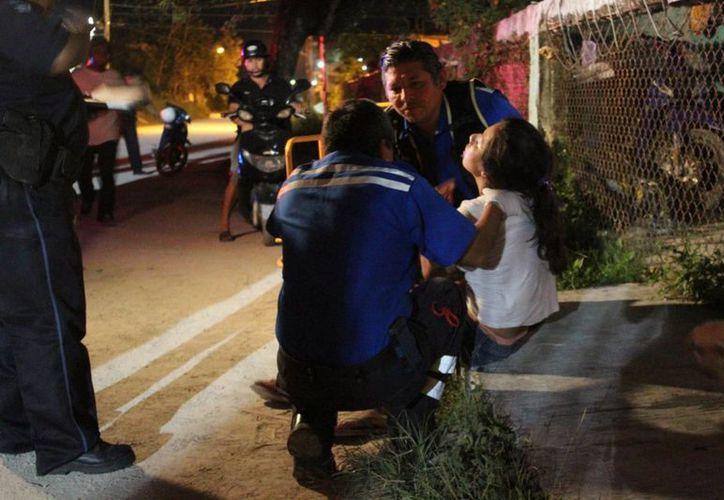 Una mujer en estado de ebriedad y embarazada fue encontrada tirada en la vía pública de Cozumel. (Redacción/SIPSE)