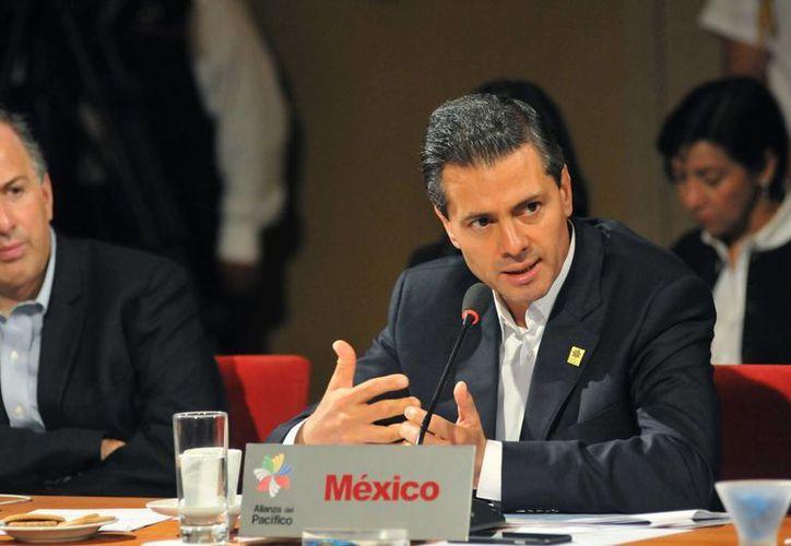 Imagen de Enrique Peña Nieto durante la inauguración de la Décima Cumbre de la Alianza del Pacífico, en la que participó junto con los mandatarios de Chile, Michelle Bachelet; de Perú, Ollanta Humala, y de Colombia, Juan Manuel Santos. (Notimex)