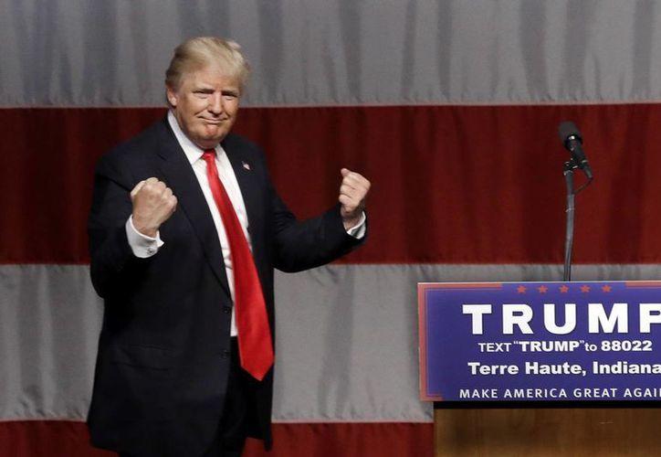 'Alguien diferente', como Donald Trump, sería la solución para los problemas de Estados Unidos, aseguran quienes le apoyan. (AP)